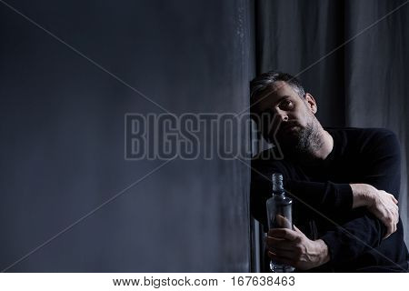 Man With Alcohol Bottle