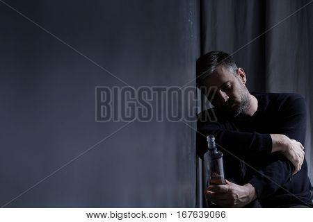 Man Holding Bottle Of Alcohol