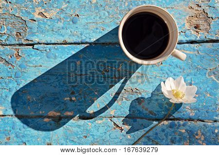 Coffee Mug With Flowers On Rustic Table
