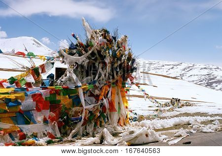Tibetan ritual prayer flags on Ma Yu La Pass with altitude 5211 meters above sea level in Western Tibet.