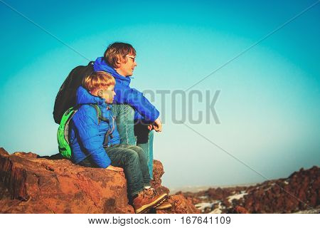 father and son hiking in mountains, family travel