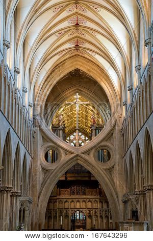 Wells United Kingdom - August 6 2016: St Andrew's Cross arches under the tower inside Wells Cathedral