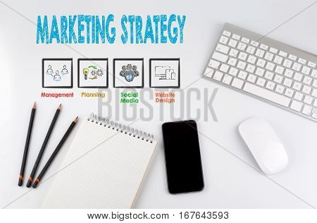 Marketing Strategy. Computer keyboard and mobile phone on a white table