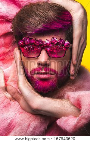 Man In A Pink Fur Coat And Carnival Glasses