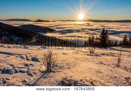 Mountain Sunrise Above Low Clouds