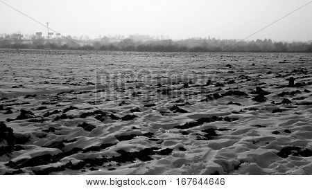 Frozen Field With Snow In The Winter