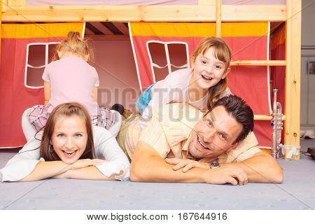 a family are lying on the nursery's floor.