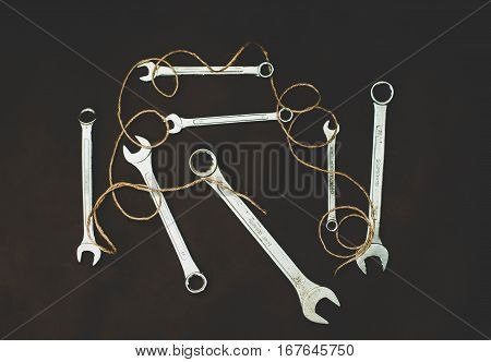 Wrenches on a brown background. Tool mechanic