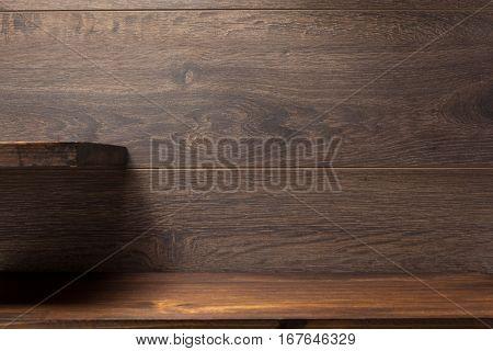 wooden shelf on brown background