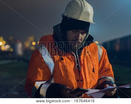 Construction worker tired and sitting asleep in the twilight. Concept of overworking