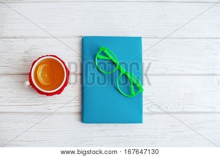 Book glasses and a cup of tea on a white background. Top view. The concept of modern education and work.