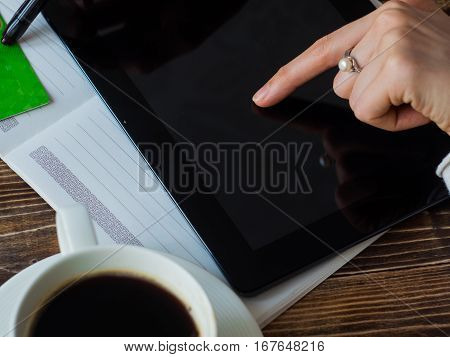 Woman shopping online with tablet close up.