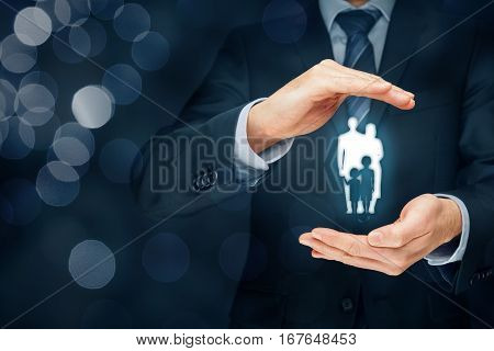 Family life insurance, family services and supporting families concepts. Businessman with protective gesture and silhouette representing young insured family.