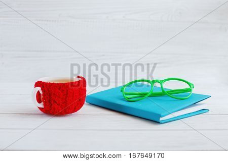 Book glasses and a cup of tea on a white background. The concept of learning and work.