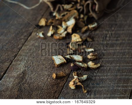 Dried Mushrooms closeup on Rustic Wooden background. Side View