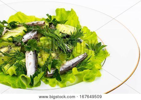Fresh vegetable salad with anchovies. Studio Photo