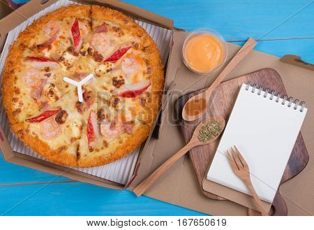 Close Up Of Delicious Seafood Hawailan Italian Pizza In Delivery Box With Origano, Chilli Pepper In