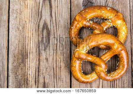 Fresh salty German bread: pretzels on a background of old boards. Studio Photo