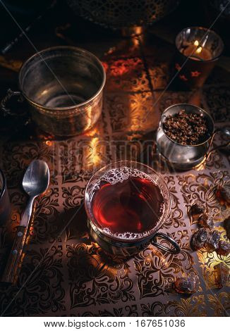 Black Tea In Cup And Candles