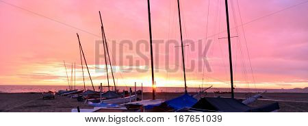 Silhouettes at the beach during a beautiful sunset on a cloudy evening Boats and sea, sunset time, soft light, sunset sea, boat on sunset, sea horizon during sunset, still sea & boat, orange sunset sky and sea