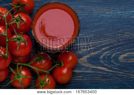 Fresh Tomato Juice On A Blue Background