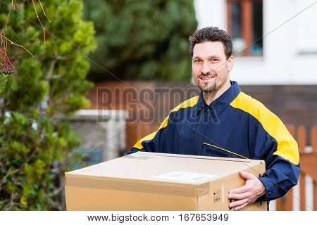Courier delivering parcel to recipient