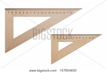 Two triangular ruler made of wood 20 and 15 centimeters on a white isolated background. Office supplies education