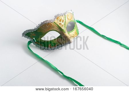 Yellow And Green Venetian Mask On White Background