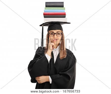 Upset graduate student with a stack of books on top of her head looking at the camera isolated on white background