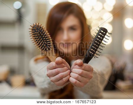 Beautiful, Attractive Girl With Long, Curly, Red Hair Holding A Hair Comb, Close-up.  Professional H