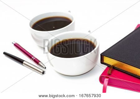 Cup Of Black Coffee, Pens And Diaries On A White Background.