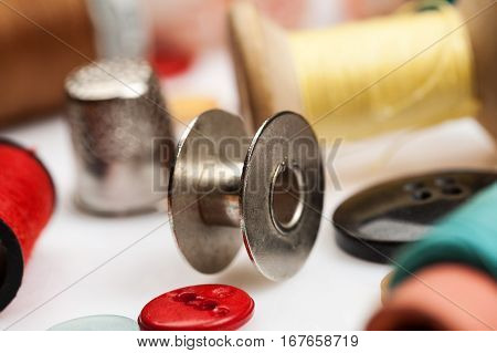 Thread Spools, Thimbles And Other Items For Sewing Close-up Shot.