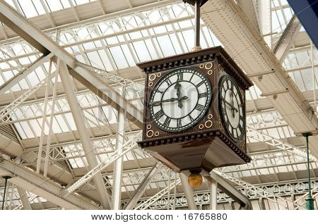 Traditional public clock in cast iron station in Glasgow Scotland. poster