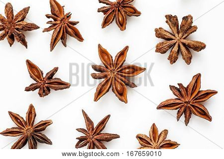 Close-up Shot Of Star Anise Flat Lay Pattern Isolated On White.