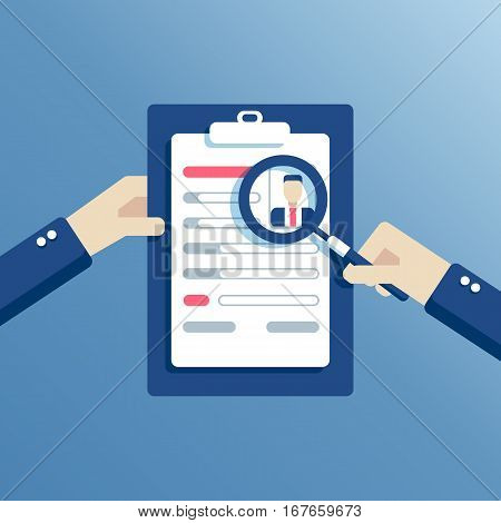 Hands holding a resume and learn it through a magnifying glass the employer is considering job candidates resume. business concept job interview
