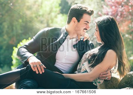 Couple love good feeling. Loving harmony. First romantic kiss. A young men and a young smiling woman. Love deep and bright feelings, relationship between men and woman. Attitude romantic and sentimental.