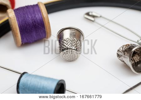 Close-up Shot Of Items For Sewing On A White Background