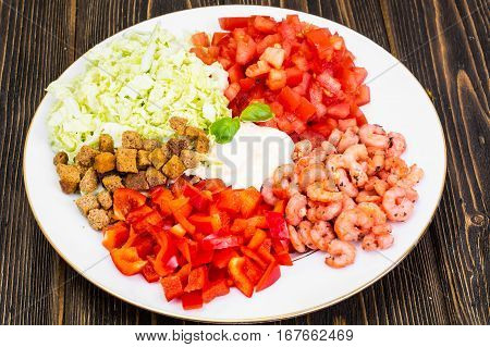 Vegetable salad with shrimps on a white background. Studio Photo