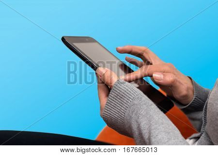 woman hands touch with finger on tablet. blue background