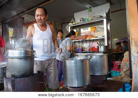 Street Vendor With His Noodle Stall In Penang, Malaysia.