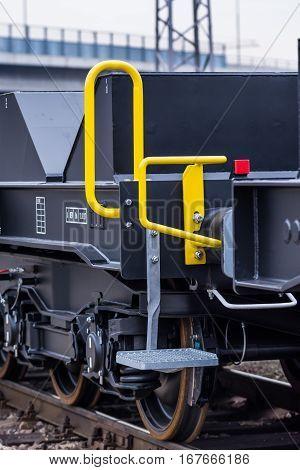 Burgas Bulgaria - January 24 2017 - Stairs - Freight cargo train - 6-axled flat wagon - Sahmmn - WW 604 A- Transvagon AD