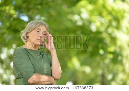 Portrait of a mature woman, upset posing outdoors
