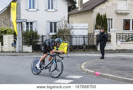 Conflans-Sainte-HonorineFrance-March 62016: The Welsh cyclist Luke Rowe of Team Sky riding during the prologue stage of Paris-Nice 2016.