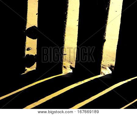 Abstract colour image of low tide wooden beach revetments