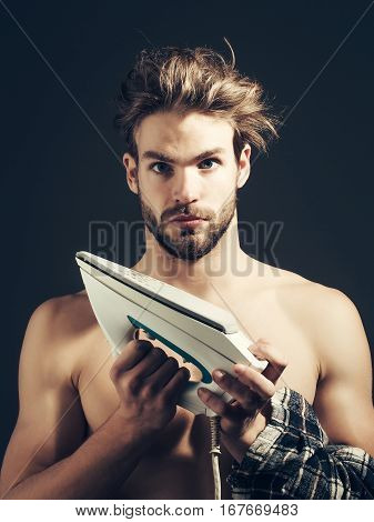 Sexy Naked Man Holds Iron