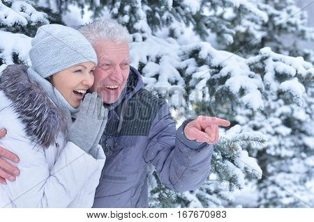 happy father with daughter, smiling and posing outdoors in winter