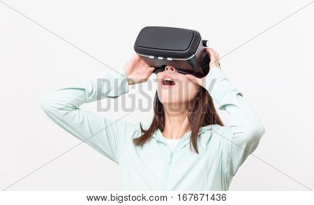 Excited woman looking though the Virtual reality glasses