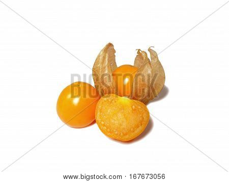 Closed up vivid yellow ripe Cape gooseberries, one with calyx, one whole, one cut in half isolated on white background