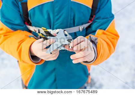 Little child holding toy airplane in hands. colorful toy and image. Kid playing with plane.