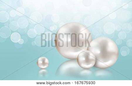 Four different size beautiful shining white pearls reflecting and isolated on shimmering aqua background